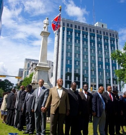Image for Photo Captures Powerful Protest of Confederate Flag Two Months Before Emanuel AME Tragedy