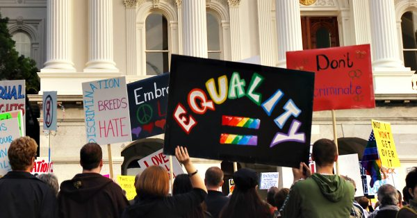 Discrimination Drives LGBTQ+ People into Poverty and the Criminal Legal System