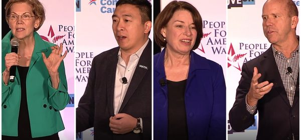 """Presidential candidates Amy Klobuchar, John Delaney, Elizabeth Warren and Andrew Yang at the """"We the People"""" democracy forum in Des Moines, Iowa."""