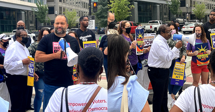 People For President Ben Jealous and People For Board Member Rev. Timothy McDonald rally the crowd at Black Lives Matter Plaza before marching to the White House on October 5, 2021.
