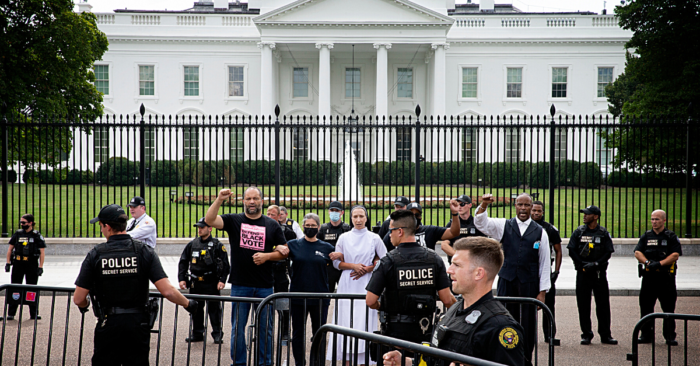 People For President Ben Jealous and four other civil rights and faith leaders are arrested for protesting peacefully at the White House on October 5, 2021.